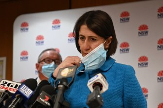 NSW Premier Gladys Berejiklian announces new COVID restrictions, including mandatory masks indoors.
