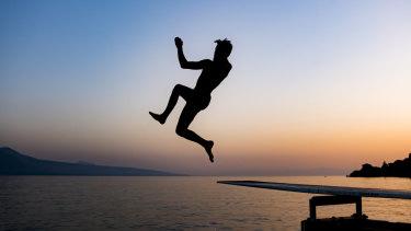 A man jumps into lake Geneva in St Saphorin, Switzerland, to escape the heat.