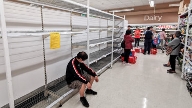 Shoppers wait for toilet paper at Coles in Epping on March 20.
