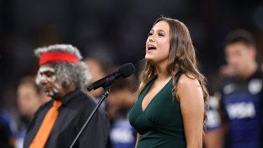 Olivia Fox sings the national anthem at Bankwest Stadium on Saturday evening.