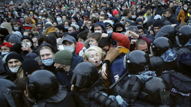 Demonstrators clash with police on Saturday during a protest against the jailing of opposition leader Alexei Navalny.