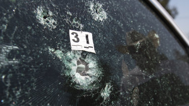The windshield of mayoral candidate Guillermo Valencia is shattered after an attack in Morelia, Michoacan state, Mexico, last month.