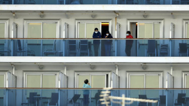 Passengers on balconies of the Diamond Princess cruise ship in Yokohama.