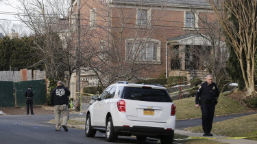 Police work near the scene in Staten Island where Cali was gunned down.
