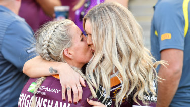 Special moment: Ali Brigginshaw kisses partner Kate Daly.