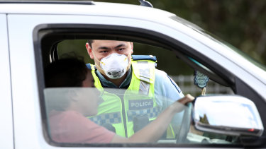 The pandemic has altered the economic outlook: NZ Police stop motorists at a checkpoint in Auckland to ensure residents are complying with the coronavirus lockdown.