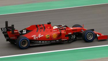 Ferrari's Sebastian Vettel takes his car through its paces at F1 testing in Barcelona.