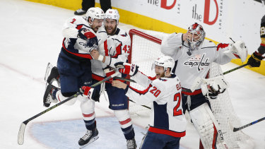 Their year: Capitals players celebrate after winning game five, and the series.