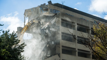 Demolition of the former CSIRO headquarters in Campbell is underway to make way for two apartment blocks and over 100 townhouses.