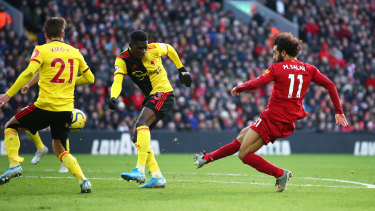 Mohamed Salah opens the scoring for Liverpool against Watford at Anfield.