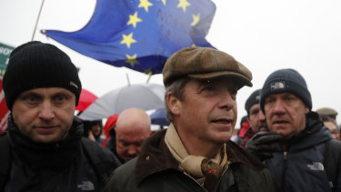 Former UKIP party leader Nigel Farage, centre, joins the start of the first leg of March to Leave the European Union, in Sunderland, England, on Saturday.