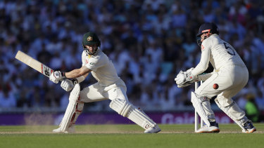 Australia's Matthew Wade plays a shot off the bowling of England's Joe Root