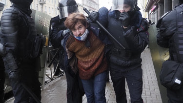 Police detain a protester during a protest against the jailing of opposition leader Alexei Navalny in St Petersburg.