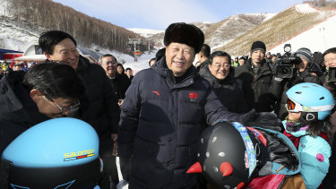 Chinese President Xi Jinping meets children attending skiing camps as he inspects preparatory work for the Beijing 2022 Winter Olympic Games.