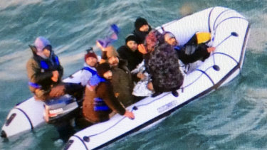 Migrants aboard a rubber boat after being intercepted by French authorities off the port of Calais in northern France.