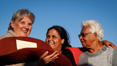 Pat Anderson (left), Sally Scales and Irene Davey in May 2017 holding a piti with the Uluru Statement from the Heart.