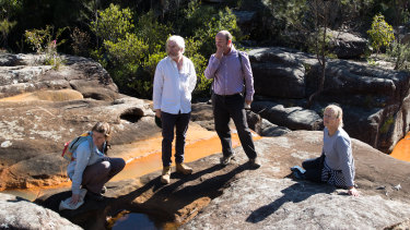 Orange is the new pristine? Visitors to one of the Special Areas of Sydney's catchment area this week, (left to right), Georgina Woods from Lock the Gate, Peter Turner of the National Parks Association, Western Sydney University's Ian Wright and Kaye Osborn from the Protect Our Water Alliance.