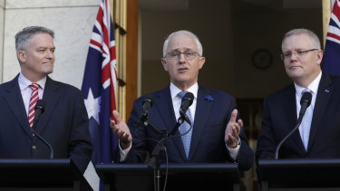Prime Minister Malcolm Turnbull, with Finance Minister Mathias Cormann and Treasurer Scott Morrison, speaks to the media following the passage of the tax legislation through the Senate.