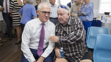 Take my advice, mate: Malcolm Turnbull and local Norm Clarke at a community lunch in Brisbane.