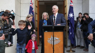 Malcolm Turnbull, pictured with his family, speaks to the media after his party room loss on Friday.