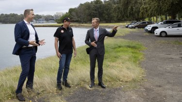 Greens MP for Balmain Jamie Parker, left, Balmain and District Football Club president Paul Avery and NSW Planning Minister Rob Stokes check out the waterfront area set for an upgrade.