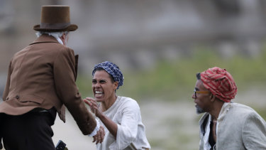 Slaves attack a slave owner during a performance reenacting the largest slave rebellion in US history.