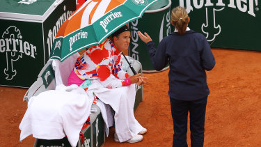 Victoria Azarenka of Belarus speaks with a match official during a rain break in her first-round match.