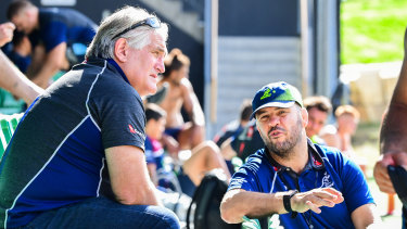 Scott Johnson (left) and Michael Cheika chat during a Wallabies training session in July.