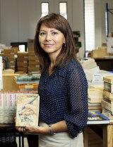 Lu Sierra a Lifeline volunteer with a James Bond first edition.