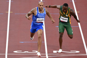 Lamont Jacobs gets in front to win gold in the men's 100m in Tokyo.