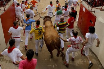 The running of the bulls at the San Fermin festival in Spain.