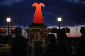 A statue of Captain Cook was removed from its base and replaced with a red dress to symbolise the murder of indigenous women.