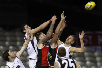Jacob Weitering of the Blues and Tim Membrey fly for the ball.