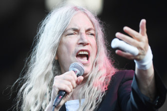 Patti Smith, her hair now a mercury shroud.