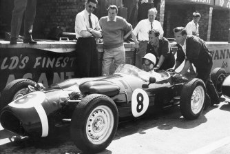 Stirling Moss, at the wheel of the revolutionary new Ferguson racing car in 1961, gets a shove off from mechanics as he takes practice laps at Silverstone, England.