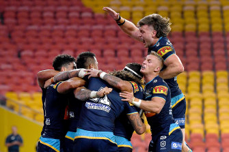 Titans players celebrate after Phillip Sami scored the winning try.