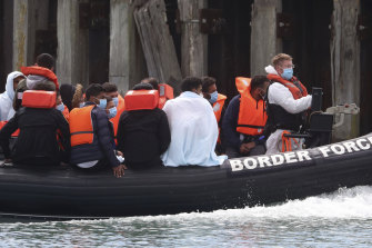 A British Border Force vessel carries a group of men thought to be migrants into Dover harbour, Southern England, last week.