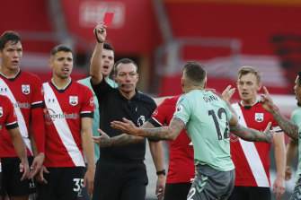 Referee Kevin Friend gives Everton's Lucas Digne is marching orders after a foul on Southampton's Kyle Walker-Peters.