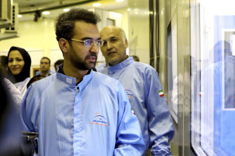 Iran's Minister of Information and Communications Technology Mohammad Javad Azari Jahromi looks at The Nahid-1 domestically-built satellite at the space research center in Tehran, Iran.