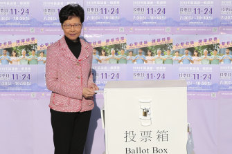 Hong Kong Chief Executive Carrie Lam casts her ballot at a polling place in Hong Kong on Sunday.