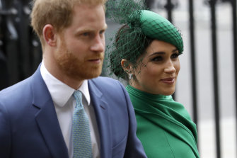 Prince Harry and Meghan pictured last year.