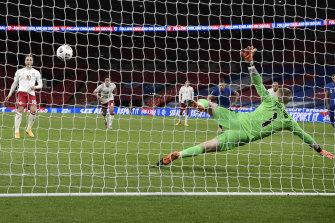 Christian Eriksen scores from the spot for Denmark.