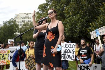 Victorian MP Catherine Cumming tries to speak at a demonstration against vaccination and COVID restrictions at Fawkner Park in February.