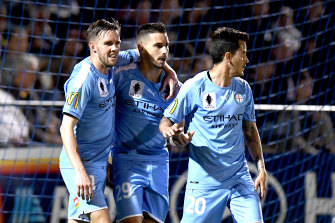 Jamie Maclaren (centre) is back for City's clash with Adelaide on Sunday.