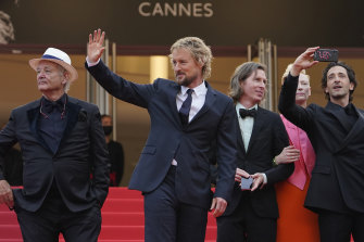 Bill Murray, Owen Wilson, director Wes Anderson, Tilda Swinton, and Adrien Brody arrive at the premiere of The French Dispatch at Cannes.