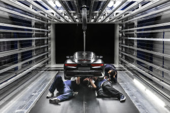 Engineers work on a scaled version of the Maserati MC20 during wind tunnel testing.
