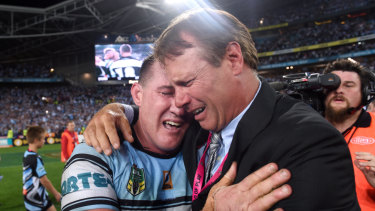 'We did it': Paul Gallen and Andrew Ettingshausen embrace after the Sharks' maiden grand final win in 2016.
