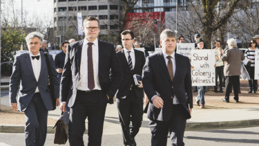 Mr Collaery's barrister Christopher Ward SC, far right, and Witness K's barrister Haydn Carmichael, far left, arriving at court earlier this year.