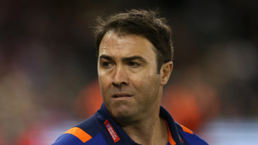 Terse response: North Melbourne coach Brad Scott threatens to ring in the changes after third loss in three games.