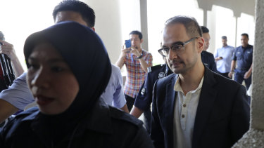 Riza Aziz, right, Hollywood producer and stepson of Malaysian former PM Najib Razak, walks into the Kuala Lumpur High Court on Friday.